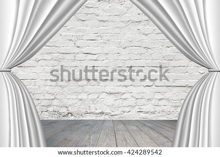 Stage with white curtains, on old brick wall background. - stock photo