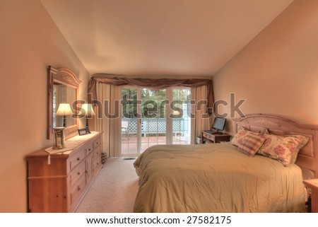 Staged bedroom in house for sale - stock photo