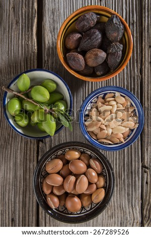 Stages of argan fruits, from fresh to seeds - stock photo