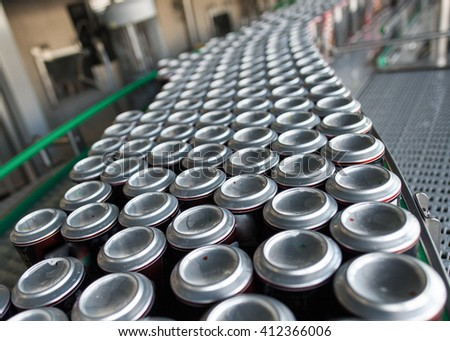 Stain-roof jars with drinks on the assembly line. for the production of alcoholic and soft drinks line. The final stage in the manufacture of the product. - stock photo