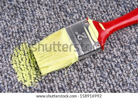 stained carpet with paint brush - stock photo