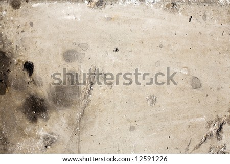 Stained, dirty concrete textures useful for backgrounds or layer effects