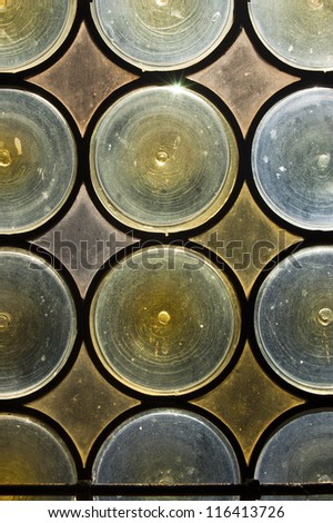 Stained Glass Background / Old window with stained glass - opaque blue and yellow circles - stock photo