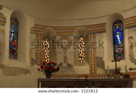 Stained glass behind a church altar in Southern France - stock photo