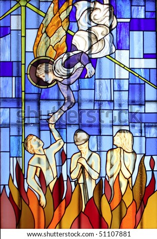 Stained glass church window; an angel from the sky holds out its hand towards an hell damned soul - stock photo