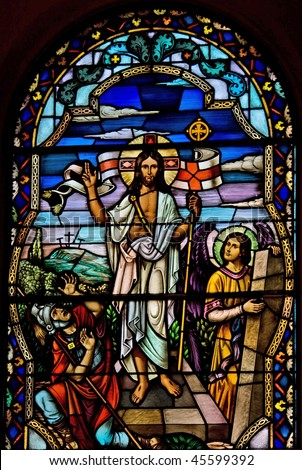 Stained glass church window depicting Jesus. - stock photo