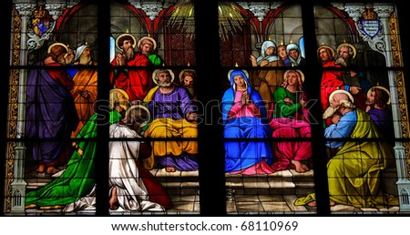 Stained glass church window depicting Pentecost in the Dom of Cologne, Germany.