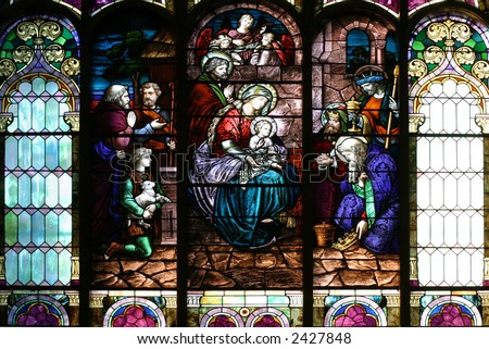 Stained Glass Church Window - Epiphany scene on a church central window. - stock photo