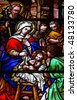 Stained glass church window (made at the end of the 19th Century) depicting the Nativity - stock photo