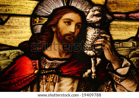 Stained glass depicting Jesus holding a lamb - stock photo