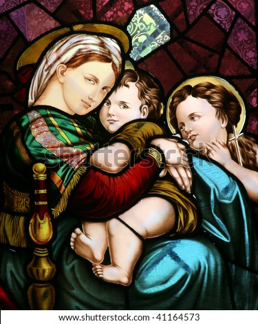 Stained glass depicting the Virgin Mary holding baby Jesus, Church of the Sacred Heart of Jesus, Zagreb, Croatia - stock photo