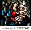 Stained glass depicting the Virgin Mary holding baby Jesus (Dome cathedral, Riga, Latvia) - stock photo