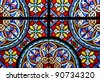 Stained glass in a cathedral - stock photo