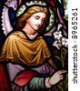 Stained glass in Catholic church in Dublin showing Archangel Gabriel - stock photo