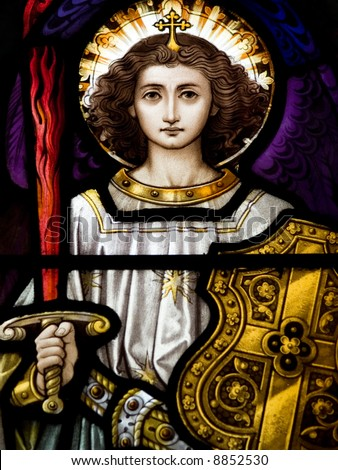 Stained glass in Catholic church in Dublin showing Archangel Michael - stock photo