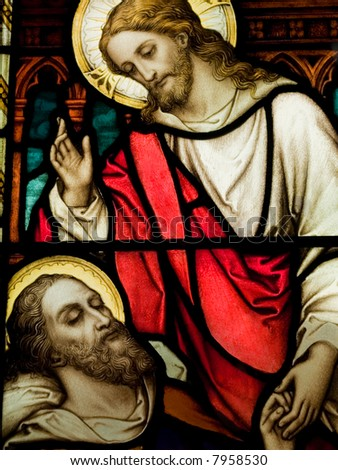 Stained glass in Catholic church in showing Christ healing a sick man - stock photo