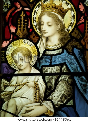 Stained glass in Catholic church showing Our Lady with Baby Jesus;