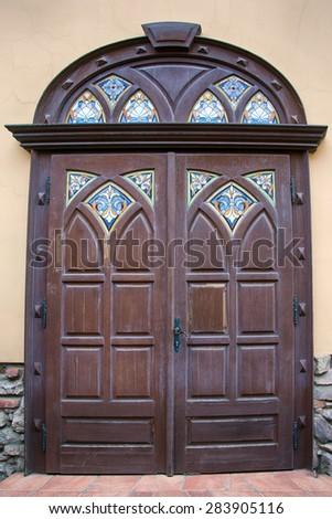 Stained glass old door of Palanok Castle in Mukachevo, Ukraine - stock photo