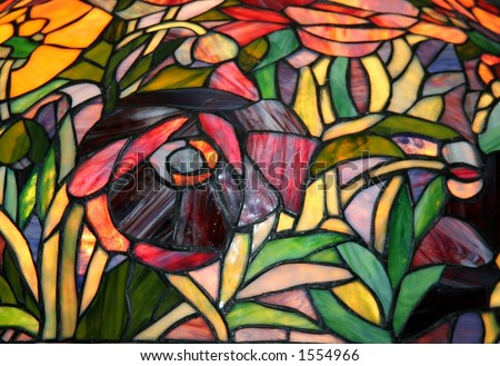 Stained glass purple poppies closeup.  Antique arts & crafts original. - stock photo