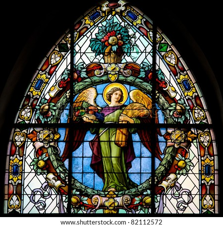 Stained glass window depicting an angel. This window is located in Saint James's Church (Swedish: Sankt Jacobs kyrka) in Stockholm, Sweden. - stock photo