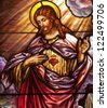 Stained glass window depicting devotion to Sacred Heart of Jesus - stock photo
