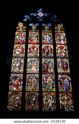Stained glass window in a catholic cathedral - stock photo