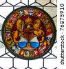 Stained glass window in ancient Kyburg castle near Zurich - stock photo