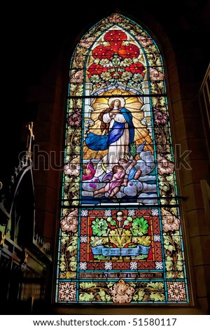 Stained glass window in historic Catholic church
