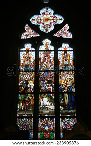 Stained-glass window in Pyotr and Pavel's basilica in fortress Vysehrad in Prague - stock photo