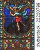 Stained glass window in St.Samson cathedral ( Dol-de-Bretagne, France) depicting The Archangel Michael. - stock photo