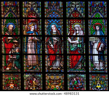 Stained glass window in the Church of Our Lady of Sablon (Notre Dame du Sablon) made in 1861 by the artist Samuel Coucke (1833-1899) - stock photo