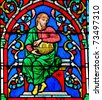Stained glass window in the Notre Dame Cathedral in Paris depicting an ancestor of Jesus Christ, as part of the Tree of Jesse. - stock photo