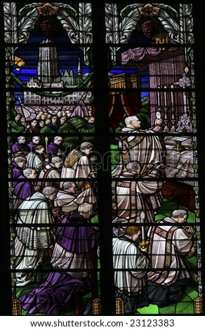 Stained glass window in the Saint Rumboldts cathedral of Mechelen, Belgium. The window was fabricated in Mechelen in 1860 - stock photo