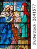 Stained glass window of  baby Jesus / 3 Wise Men from 1899 - stock photo