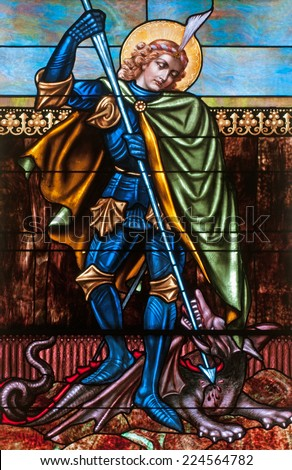 Stained glass window of St. George slaying the dragon - stock photo
