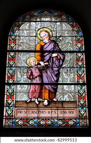 Stained glass window with Saint Joseph and Jesus