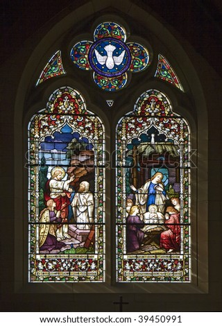 Stained glass windows representing the Nativity Scene - Christmas - stock photo