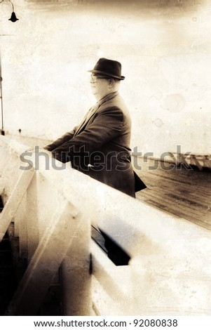 Stained Grungy Sepia Portrait Of An Olden Day Man Wearing Business Suit Looking In The Distance With Thought And Recollection In A Life Of Memoirs Concept - stock photo