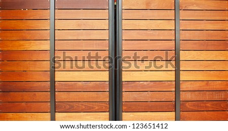 Stained wood framed in steel garage doors horizontal - stock photo