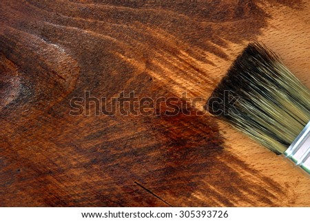 Staining wooden surface. Home decorating concept. DIY - stock photo
