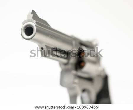 Stainless 357 Magnum Revolver isolated on White Shallow Focus  - stock photo