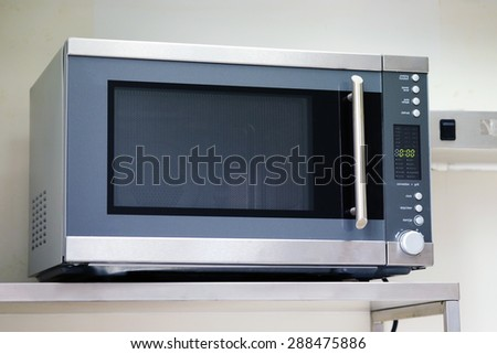 stainless microwave oven in kitchen - stock photo