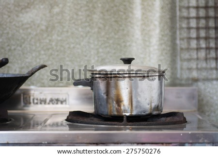 Stainless old pot in the kitchen. - stock photo