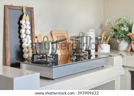 stainless pan on gas stove with utensil in modern kitchen - stock photo