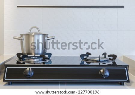 stainless pot on gas stove in kitchen - stock photo