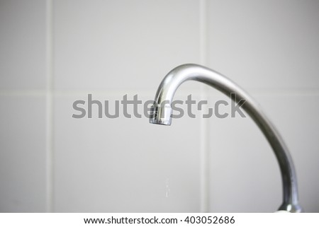 stainless sink tap in the kitchen  - stock photo