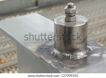 Stainless steel attached on carbon steel as function for earthing point with bold and nut. For oil and gas industries. - stock photo