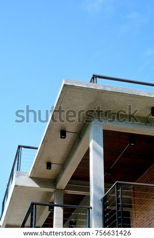 Stainless Steel balcony railing with bright sky background. Modern loft style exterior.
