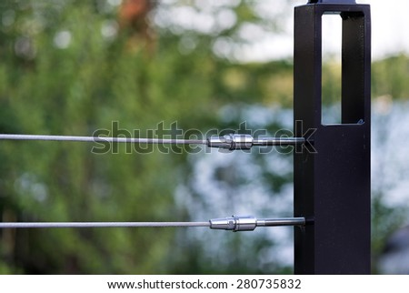 Stainless steel cable and tensioners - stock photo