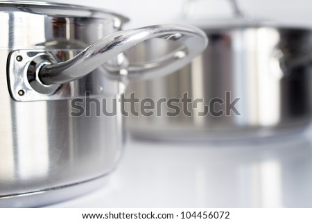Stainless steel casserole - stock photo